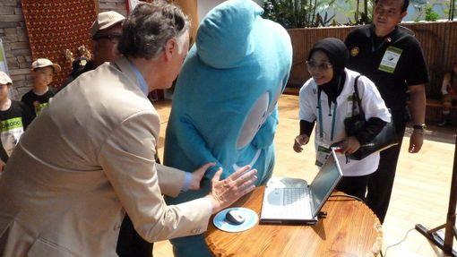 """Haibao"", the Official EXPO 2010 mascot, tries his hand at democracy."