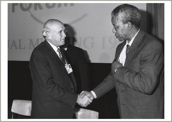 FW de Klerk and Nelson Mandela shaking hands