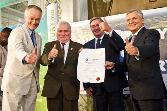 New7Wonders president Bernard Weber (left) presenting the Official Finalist Certificate for the Masurian Lake District in the New7Wonders of Nature to three presidents of Poland: Lech Wałęsa, Bronisław Komorowski and Aleksander Kwaśniewski