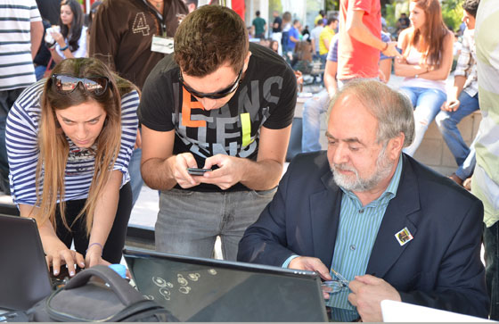 Encouraged by Dr Nabil Haddad (right) Notre Dame University–Louaize students vote in the New7Wonders of Nature