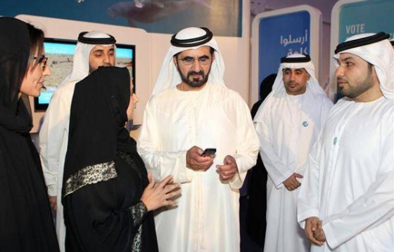 His Highness Sheikh Mohammad Bin Rashid Al Maktoum (centre) voting during his visit  to the Bu Tinah Experience on the Abu Dhabi Corniche.