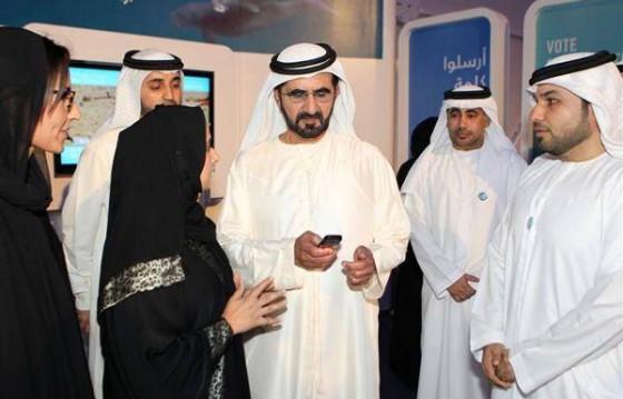His Highness Sheikh Mohammad Bin Rashid Al Maktoum (centre) voting during his visit  to the Bu Tinah Experience on the Abu Dhabi Corniche.