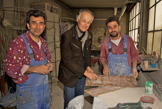 Bernard Weber, Founder-President of New7Wonders (centre), with Hasan Göktepe (left) and Aslan Göktepe (right) of the Kunstgießerei München inspecting the Puerto Princesa Underground River plaque.