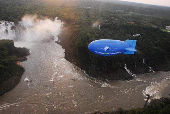 The New7Wonders blimp glides above the splendour of Iguazu Falls