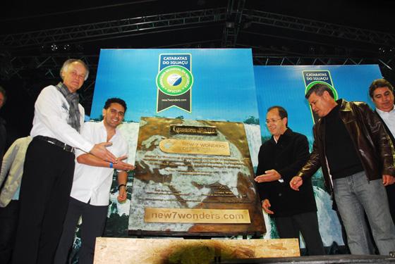 Bernard Weber (left), Founder President of New7Wonders, at the presentation of commemorative bronze plaque in Foz do Iguaçu in Paraná state, Brazil, listing Iguazu Falls as one of the New7Wonders of Nature.