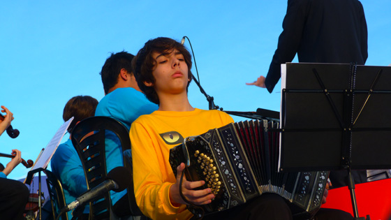 Young bandoneón player at the official inauguration of Iguazu Falls as one of the New7Wonders of Nature. The bandoneón is a type of concertina particularly popular in Argentina.