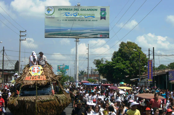 Colourful floats, many of which featured representatives of the indigenous rainforest communities, formed part of the 20km-long parade through Iquitos.