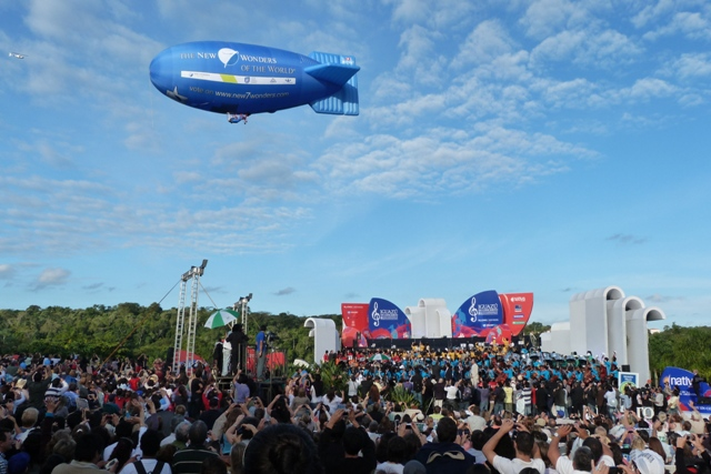 As the New7Wonders airship hovers above the rainforest, the assembled crowds celebrate the inclusion of Iguazu Falls in Global Memory.