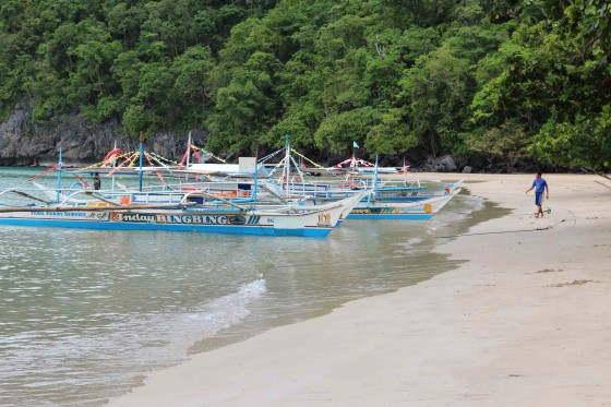 Sustainable development in the form of locally-operated boats beached at the entrance to the Puerto Princesa Underground River (PPUR) in Palawan Province.