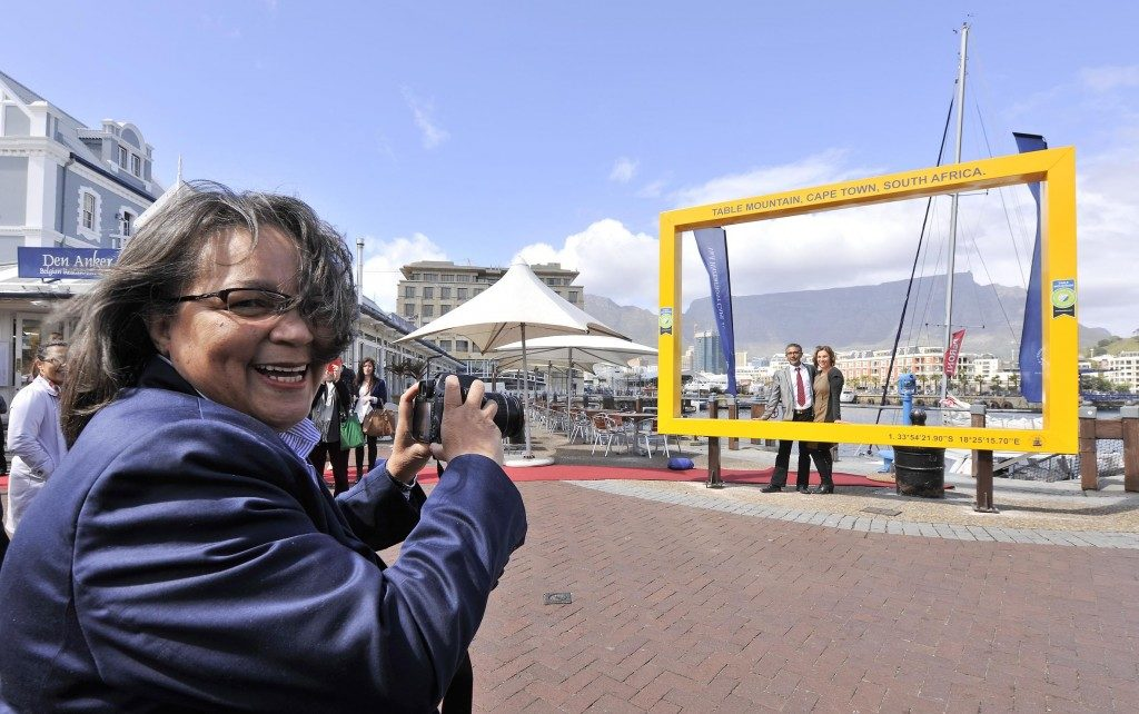 Cape Town Mayor Patricia de Lille in the foreground with Table Mountain in the background, as seen through the New7Wonders legacy picture frame on the V&A Waterfront.