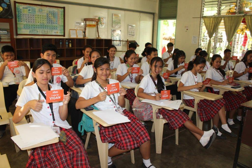 These cheerful school children in Vigan, the Philippines, have filled out their voting postcards.