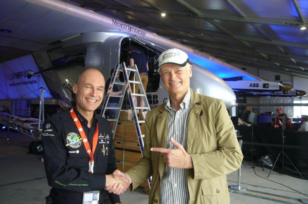 Abu Dhabi: Solar Impulse pilot Bertrand Piccard (left) receiving good luck wishes from Bernard Weber, Founder  of New7Wonders (right), before his historic flight.