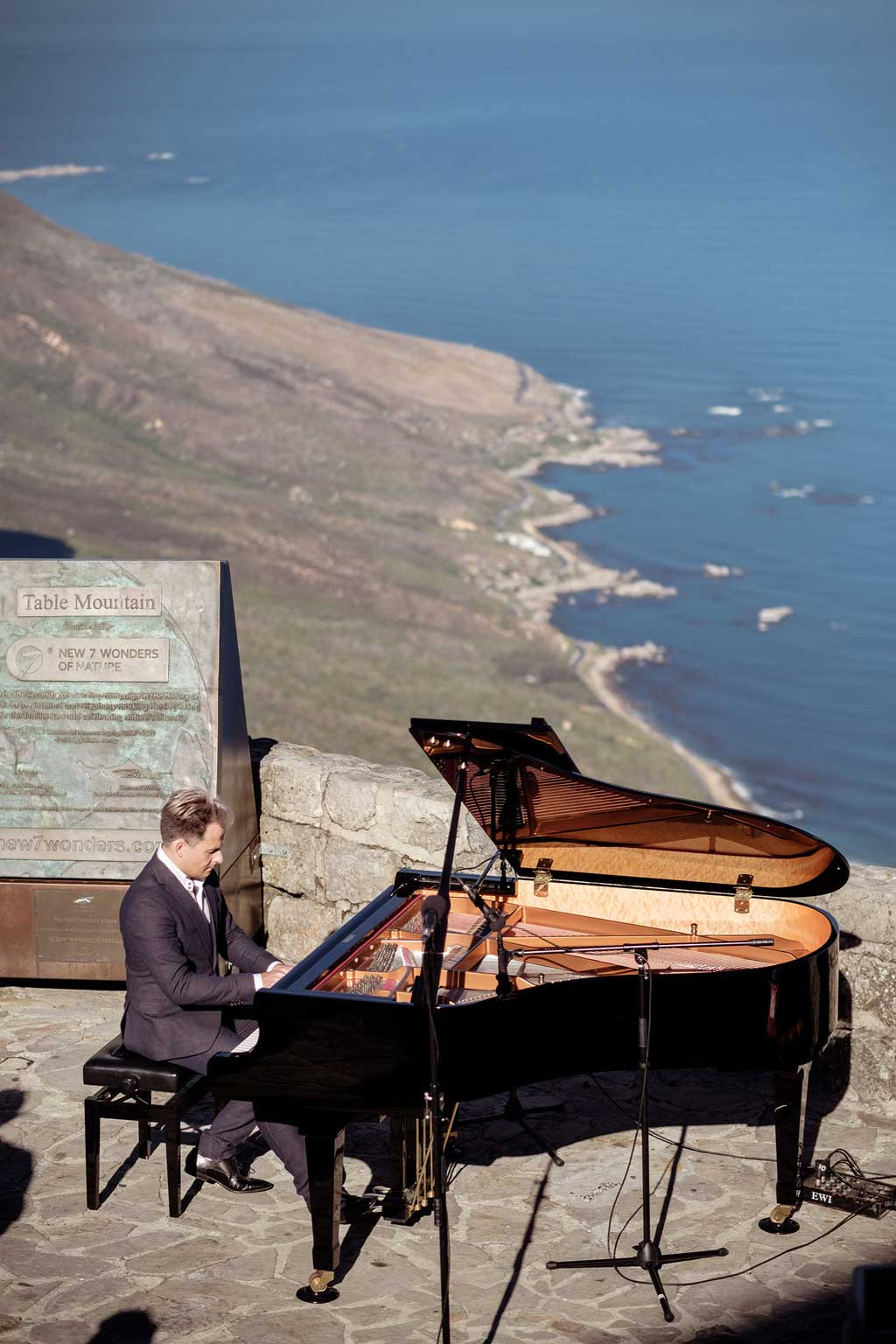 With the New7Wonder of Nature commemorative plaque in the background, Charl du Plessis serenades Table Mountain